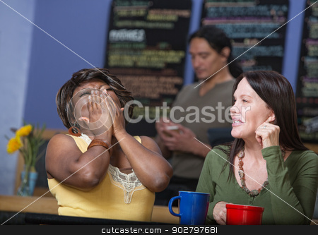 Laughing Friends in Cafe stock photo, Laughing African woman with European woman in cafe by Scott Griessel