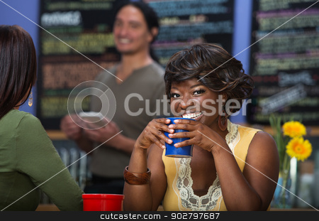 Pretty Woman with Coffee stock photo, Pretty African woman with coffee mug in cafe by Scott Griessel