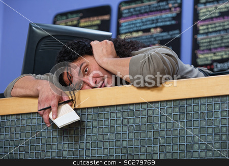 Exhausted Man Laying on Counter stock photo, Exhausted Native American restaurant owner laying on counter by Scott Griessel