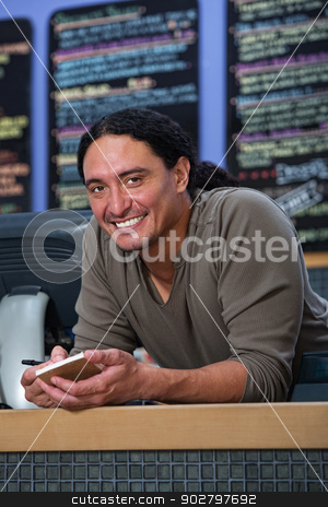 Smiling Cafe Owner stock photo, Handsome Native American restaurant owner at counter by Scott Griessel