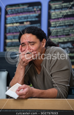Overwhelmed Restaraunt Worker stock photo, Overwhelmed Hispanic male restaurant owner at counter by Scott Griessel