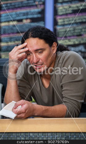 Tired Cafe Worker stock photo, Stressed out male restaurant worker at counter by Scott Griessel