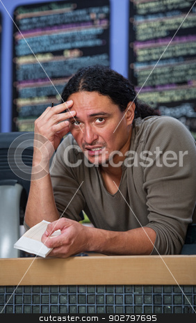 Overworked Cafe Owner stock photo, Stressed out Native American restaurant owner at counter by Scott Griessel