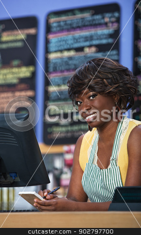 Coffee House Waitress stock photo, Beautiful woman with apron taking orders on notepad by Scott Griessel