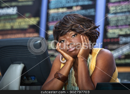 Bored Coffee House Waitress stock photo, Bored African woman with apron behind restaurant counter by Scott Griessel