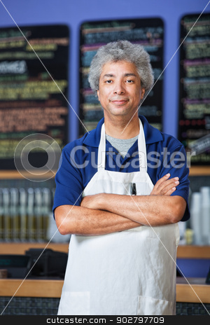 Man in Apron with Folded Arms stock photo, Confident mature Black cafe owner in apron  by Scott Griessel