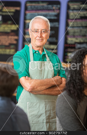 Senior Coffee House Owner stock photo, Confident mature Caucasian male with folded arms by Scott Griessel