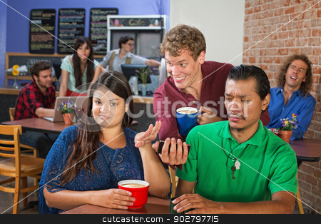 Irritated Couple and Strange Man stock photo, Strange man showing disgusted couple his phone by Scott Griessel