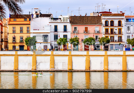 Houses Stores Restaurants Cityscape Boats River Guadalquivr Morn stock photo, Houses Stores Restaurants Boats River Guadalquivr Morning Reflection Houses Cityscape Seville Andalusia Spain.   by William Perry