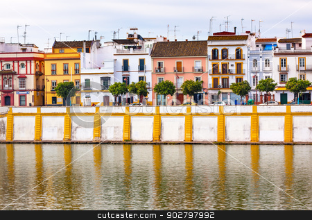 Houses Stores Restaurants Cityscape River Guadalquivr Morning Se stock photo, Houses Stores Restaurants River Guadalquivr Morning Reflection Houses Cityscape Seville Andalusia Spain.   by William Perry