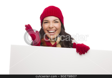 Thrilled Girl Wearing Winter Hat and Gloves Holds Blank Sign  stock photo, Excited Girl Wearing Winter Hat and Gloves Holds Blank Sign Isolated on White Background. by Andy Dean