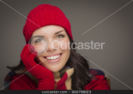 Smilng Mixed Race Woman Wearing Winter Hat and Gloves  stock photo, Happy Mixed Race Woman Wearing Winter Hat and Gloves on Gray Background. by Andy Dean