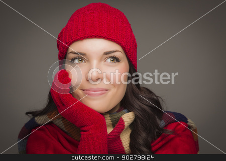 Mixed Race Woman Wearing Mittens Looks to Side stock photo, Happy Mixed Race Woman Wearing Winter Hat and Gloves Looking to the Side on Gray Background. by Andy Dean