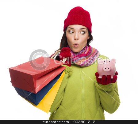 Concerned Mixed Race Woman Holding Shopping Bags and Piggybank stock photo, Concerned Mixed Race Woman Wearing Winter Clothes Holding Shopping Bags and Piggybank Isolated on White Background. by Andy Dean