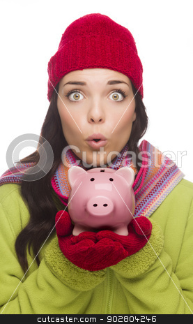 Expressive Mixed Race Woman Wearing Winter Hat Holding Piggybank stock photo, Expressive Mixed Race Woman Wearing Winter Clothing Holding Piggybank Isolated on White Background. by Andy Dean
