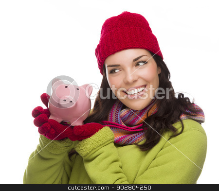 Mixed Race Woman Wearing Winter Hat Holding Piggybank on White  stock photo, Happy Mixed Race Woman Wearing Winter Clothing Holding Piggybank Isolated on White Background. by Andy Dean