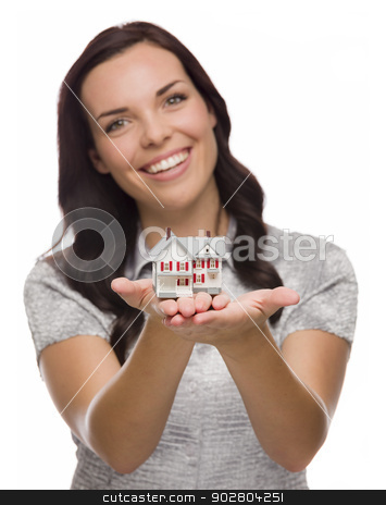 Pretty Mixed Race Woman Holding Small House Isolated on White stock photo, Mixed Race Woman Holding Small House Isolated on White Background - Focus is On The House. by Andy Dean
