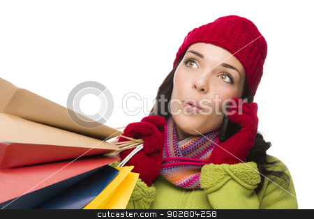 Mixed Race Woman Holding Shopping Bags On Cell Phone Looking stock photo, Mixed Race Woman Wearing Winter Clothing Holding Shopping Bags Talking On Cell Phone Looking Up and to Side Isolated on White. by Andy Dean
