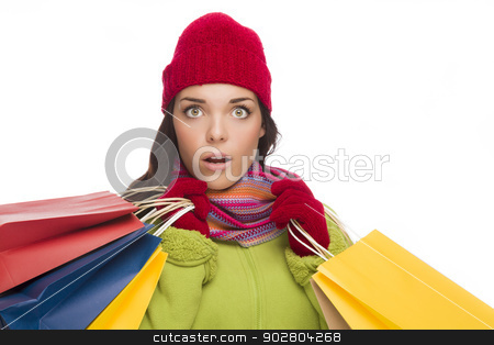 Mixed Race Woman Wearing Hat and Gloves Holding Shopping Bags stock photo, Beautiful Mixed Race Woman Wearing Winter Hat and Gloves Isolated on a White Background. by Andy Dean