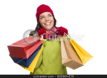 Mixed Race Woman Wearing Hat and Gloves Holding Shopping Bags stock photo, Beautiful Mixed Race Woman Wearing Winter Hat and Gloves Isolated on a White Background Looking to the Side. by Andy Dean
