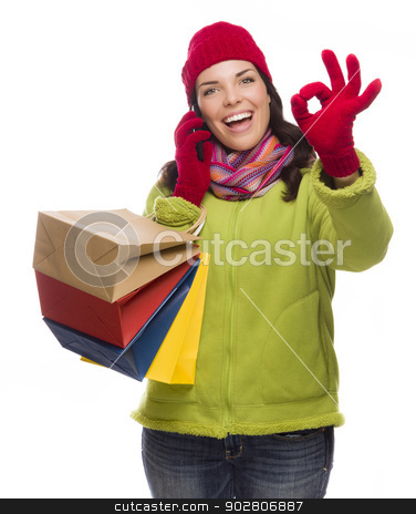 Mixed Race Woman Holding Shopping Bags On Phone Ok Gesture stock photo, Mixed Race Woman Holding Shopping Bags Talking On Her Cell Phone Giving Ok Gesture Isolated on White Background.  by Andy Dean