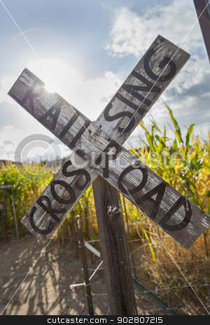 Antique Country Rail Road Crossing Sign Near a Corn Field stock photo, Antique Country Rail Road Crossing Sign Near a Corn Field in a Rustic Outdoor Setting.  by Andy Dean