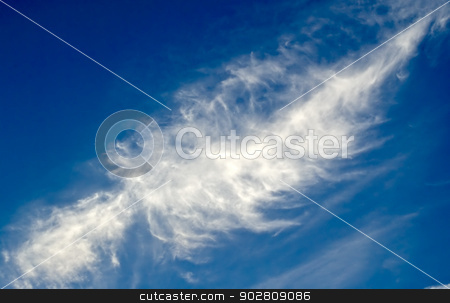 Wispy cirrus on azure blue sky stock photo, Large wispy cirrus cloud in diagonal feather shape on azure blue sky background. by ArchonCodex