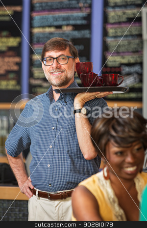 Barista Serving Drinks stock photo, Man with glasses serving drinks to customers by Scott Griessel