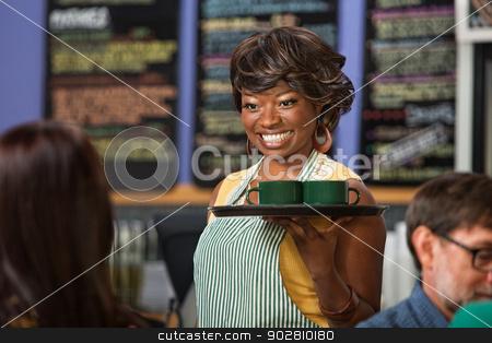 Beautiful Woman Serving Drinks stock photo, Beautiful Black woman in apron serving drinks on a tray by Scott Griessel
