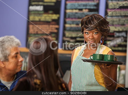 Pretty Cafe Owner stock photo, Pretty woman with grin serving coffee to customers by Scott Griessel