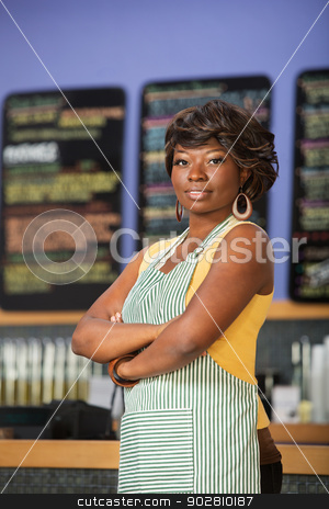 Confident Cafe Worker stock photo, Confident Black woman in apron working in coffee house by Scott Griessel