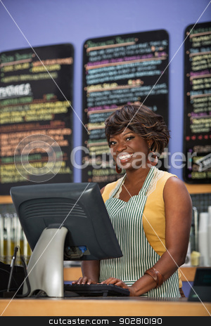 Gorgeous Cafe Owner stock photo, Gorgeous Black woman in apron working in coffee house by Scott Griessel