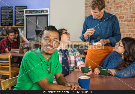 Smiling Man with Friends and Barista stock photo, Grinning Asian man with friends and barista by Scott Griessel