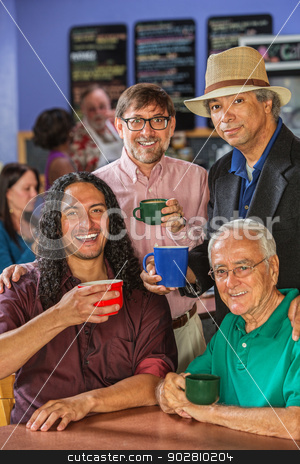Diverse Men in Coffee House stock photo, Diverse group of handsome men in coffee house by Scott Griessel