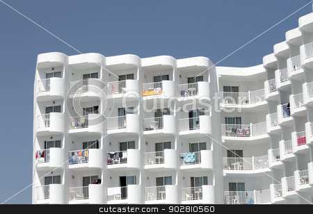 Tall white tourist hotel stock photo, Tall white tourist hotel on island of Majorca, Spain. by Martin Crowdy