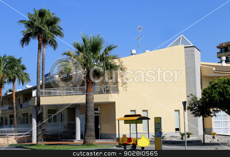 Tourist hotel complex stock photo, Tourist hotel complex on island of Majorca with bus stop in foreground, Spain. by Martin Crowdy