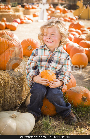 Little Boy Sitting and Holding His Pumpkin at Pumpkin Patch stock photo, Adorable Little Boy Sitting and Holding His Pumpkin in a Rustic Ranch Setting at the Pumpkin Patch.  by Andy Dean