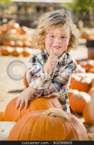 Little Boy Gives Thumbs Up  at Pumpkin Patch stock photo, Adorable Little Boy Leaning on Pumpkin Gives a Thumbs Up in a Rustic Ranch Setting at the Pumpkin Patch. by Andy Dean