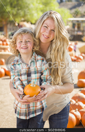 Attractive Mother and Son Portrait at the Pumpkin Patch stock photo, Attractive Mother and Son Portrait in a Rustic Ranch Setting at the Pumpkin Patch. by Andy Dean