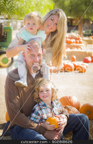 Attractive Family Portrait at the Pumpkin Patch stock photo, Attractive Family Portrait in a Rustic Ranch Setting at the Pumpkin Patch.  by Andy Dean