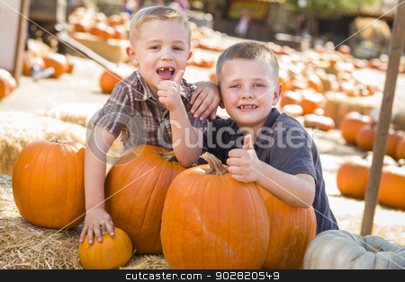 Two Boys at the Pumpkin Patch with Thumbs Up stock photo, Two Boys at the Pumpkin Patch with Thumbs Up and Having Fun on a Fall Day.  by Andy Dean