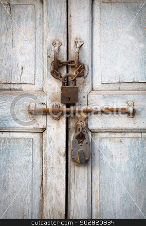 Two padlocks on the old door stock photo, Two vintage padlocks on the old door by Alexey Romanov