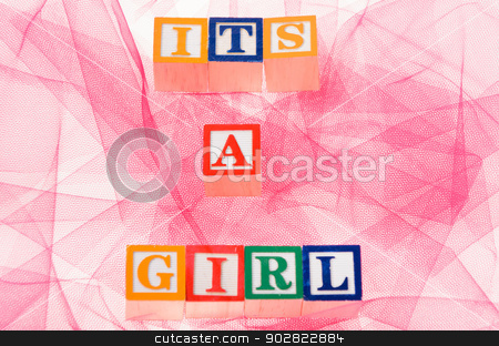Letter blocks spelling 'its a girl' stock photo, Letter blocks spelling its a girl shot on a pink background by Richard Nelson