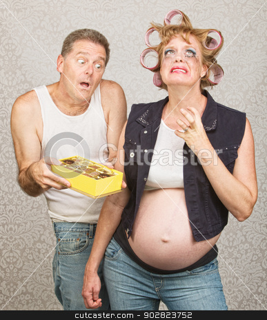 Moody Pregant Lady and Man stock photo, Moody redneck hillbilly pregnant couple with candy by Scott Griessel