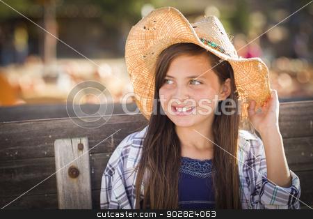 Preteen Girl Portrait at the Pumpkin Patch stock photo, Preteen Girl Wearing Cowboy Hat Portrait at the Pumpkin Patch in a Rustic Setting. by Andy Dean