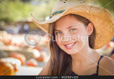 Preteen Girl Portrait Wearing Cowboy Hat at Pumpkin Patch stock photo, Preteen Girl Portrait Wearing Cowboy Hat at Pumpkin Patch in Rustic Setting. by Andy Dean