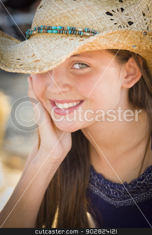 Preteen Girl Portrait Wearing Cowboy Hat stock photo, Preteen Girl Portrait Wearing Cowboy Hat in Rustic Setting. by Andy Dean