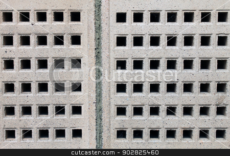 Air bricks stock photo, Abstract background of air bricks on exterior of building. by Martin Crowdy