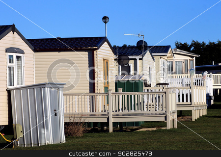 Caravans on trailer park stock photo, Scenic view of row of caravans on trailer park, Scarborough, England. by Martin Crowdy