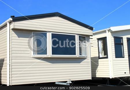 Modern trailer or caravan park stock photo, Scenic view of modern trailers and caravans in park. by Martin Crowdy